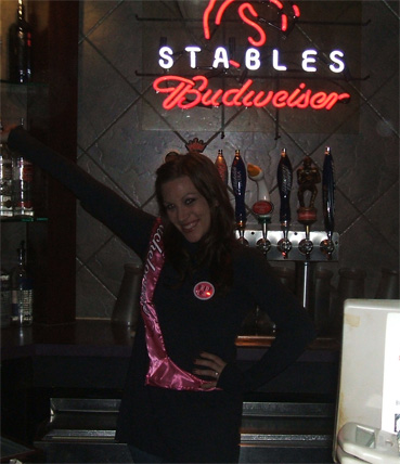 Jessica Harp Posing Under the Stables Sign